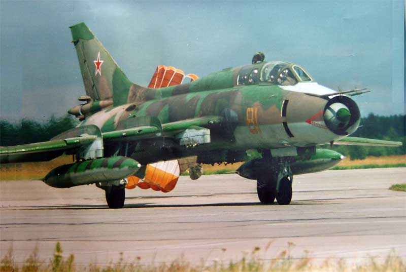Su-17UM paintwork repaired with bright green and sand yellow